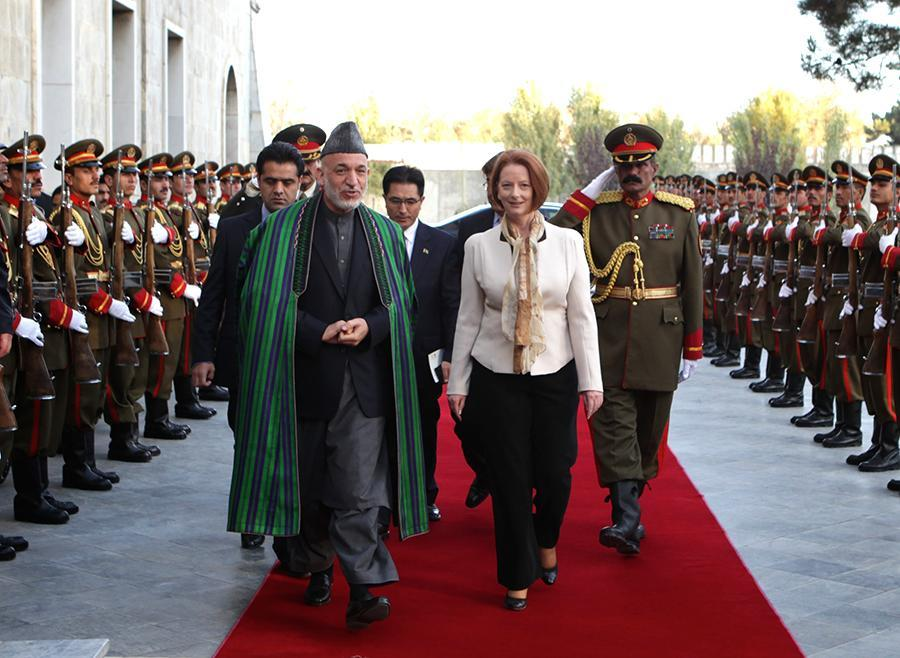 <p>When she was Australia's prime minister, Julia Gillard opted to leave her head uncovered during a 2011 meeting with President Hamid Karzai of Afghanistan in Kabul. (Photo: Getty Images) </p>