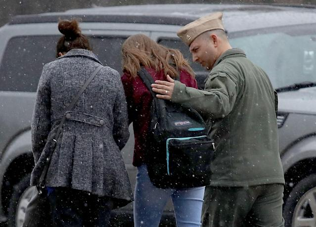 <p>A student from Great Mills High School is comforted be her guardians while being picked up at Leonardtown High School following a school shooting at Great Mills High School March 20, 2018 in Leonardtown, Md. (Photo: Win McNamee/Getty Images) </p>