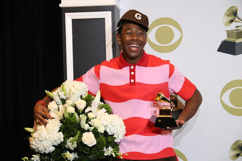 "Tyler, the Creator poses with his Grammy for best rap album (""Igor"") backstage at the 62nd annual Grammy Awards ceremony."