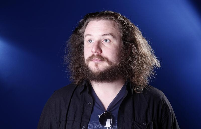 """FILE - This March 15, 2012 file photo shows musician Jim James in New York. James has picked """"Sleep No More"""" as one of the stops on his tour promoting """"Regions of Light and Sound of God,"""" his first full-length solo album. Now approaching its second year, """"Sleep No More"""" has found itself evolving into a music destination in addition to a theatrical one. (AP Photo/Carlo Allegri, file)"""