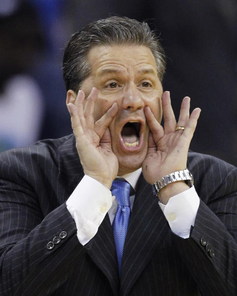 Kentucky head coach John Calipari yells in directions to his team during the second half of an NCAA college basketball game against Vanderbilt in the championship game of the 2012 Southeastern Conference tournament at the New Orleans Arena in New Orleans, Sunday, March 11, 2012. (AP Photo/Bill Haber)