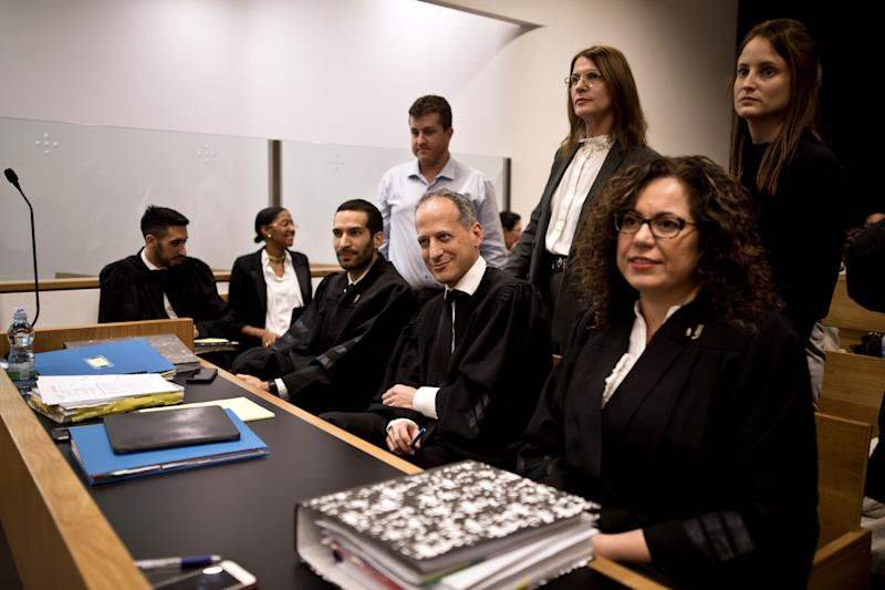 A legal team, including attorney Ran Sprinzak, attends a court hearing on Amnesty International's legal bid to have Israel revoke the export license of the Israeli NSO surveillance firm, at Tel Aviv's District Court, Israel