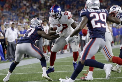 New York Giants running back Wayne Gallman (22) runs for a touchdown in the second half of an NFL preseason football game against the New England Patriots, Thursday, Aug. 29, 2019, in Foxborough, Mass. (AP Photo/Steven Senne)