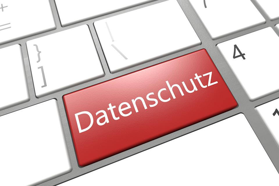 Security Concept: modern keyboard with a red Datenschutz key - the german word for data protection