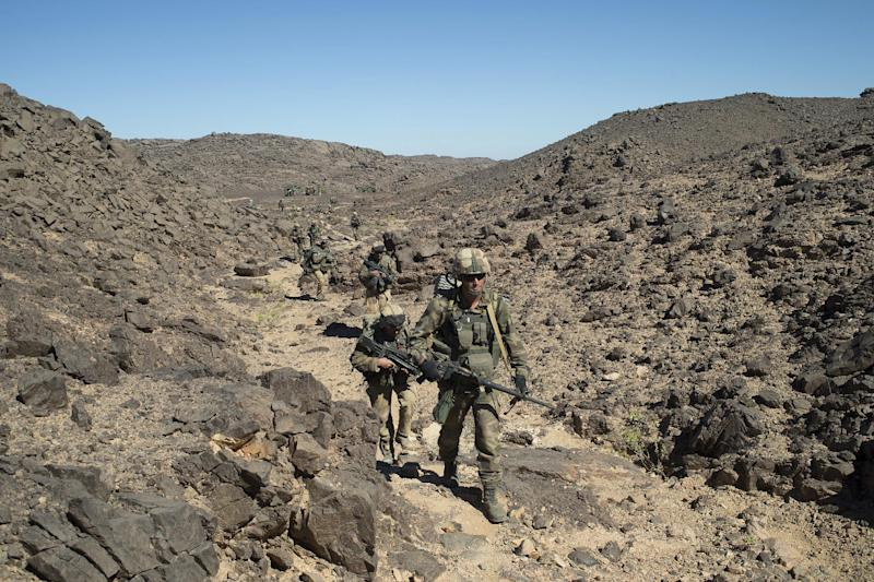 FILE - In this photo taken March 8, 2013  by the French Army Communications Audiovisual office (ECPAD) shows French soldiers patrolling in the Mettatai region in northern Mali. France's Presidential office on Saturday March 23 2013 said that DNA testing has shown that Al-Qaida-linked North African warlord Abou Zeid was killed in combat with French troops in Mali in February. Chad's President had claimed earlier that his troops had killed Zeid. (AP Photo/Arnaud Roine/ECPAD, file)