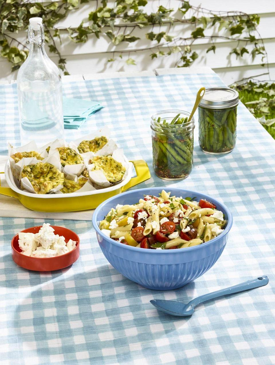 """<p>This pasta salad could be an appetizer or a side dish.</p><p><em><strong><a href=""""https://www.womansday.com/food-recipes/food-drinks/recipes/a55303/marinated-tomato-pasta-salad-recipe/"""" rel=""""nofollow noopener"""" target=""""_blank"""" data-ylk=""""slk:Get the Marinated Tomato Pasta Salad recipe."""" class=""""link rapid-noclick-resp"""">Get the Marinated Tomato Pasta Salad recipe.</a></strong></em></p>"""
