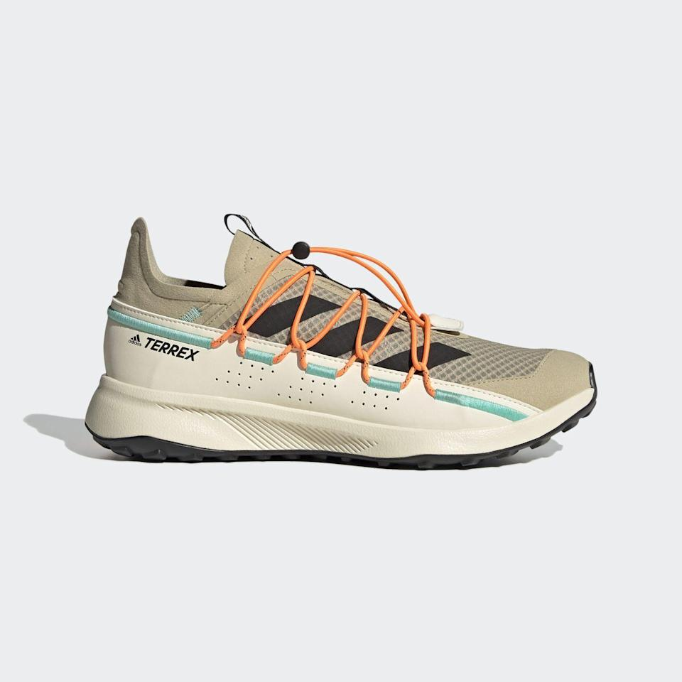 """<p><a class=""""link rapid-noclick-resp"""" href=""""https://go.redirectingat.com?id=127X1599956&url=https%3A%2F%2Fwww.adidas.co.uk%2Fterrex-voyager-21-travel-shoes%2FFW9406.html&sref=https%3A%2F%2Fwww.townandcountrymag.com%2Fuk%2Fstyle%2Ffashion%2Fg36230434%2F10-of-the-best-sporty-trainers%2F"""" rel=""""nofollow noopener"""" target=""""_blank"""" data-ylk=""""slk:SHOP NOW"""">SHOP NOW</a></p>"""