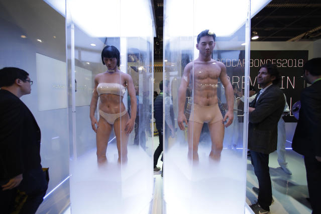 "Human sleeves are on display to promote Netflix's sci-fi series ""Altered Carbon"" at CES International Tuesday, Jan. 9, 2018, in Las Vegas. (AP Photo/Jae C. Hong)"