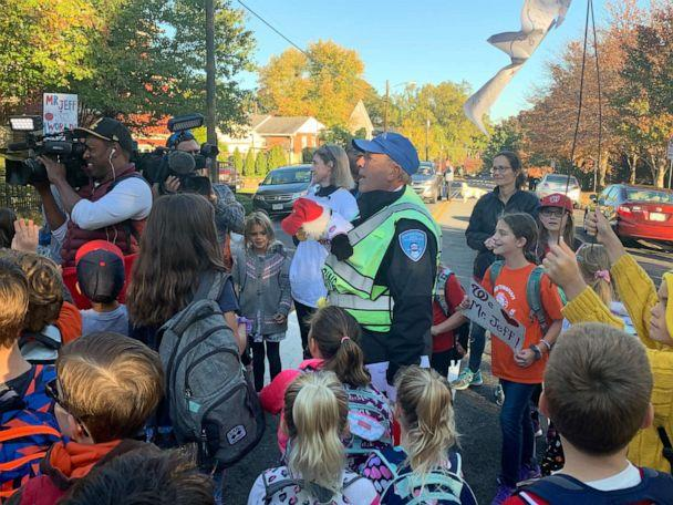 PHOTO: Beloved crossing guard surprised with World Series tickets by community. (Catherine Ashby)