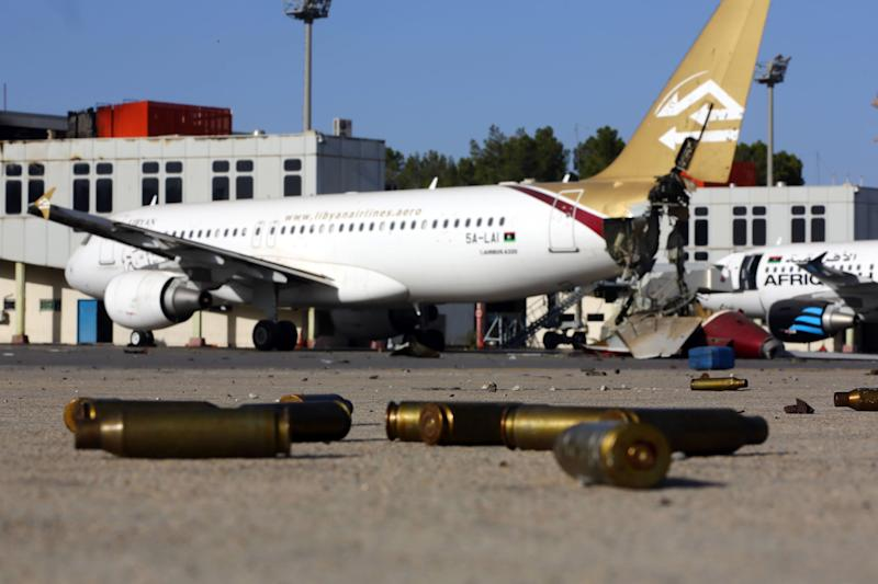 A picture taken on August 26, 2014 shows bullet casing and damaged airplanes on the tarmac at Tripoli international airport (AFP Photo/Mahmud Turkia)