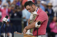 Jon Rahm, of Spain, holds the champions trophy after the final round of the U.S. Open Golf Championship, Sunday, June 20, 2021, at Torrey Pines Golf Course in San Diego. (AP Photo/Gregory Bull)