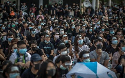 <span>Secondary school students attend an anti-government rally in Hong Kong</span> <span>Credit: ROMAN PILIPEY/EPA-EFE/REX </span>
