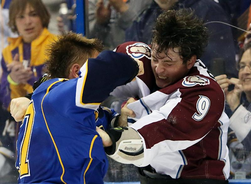 St. Louis Blues left wing Vladimir Sobotka, left, fights with Colorado Avalanche center Matt Duchene during the second period of an NHL hockey game, Thursday, Nov. 14, 2013, in St. Louis. (AP Photo/St. Louis Post-Dispatch, Chris Lee)