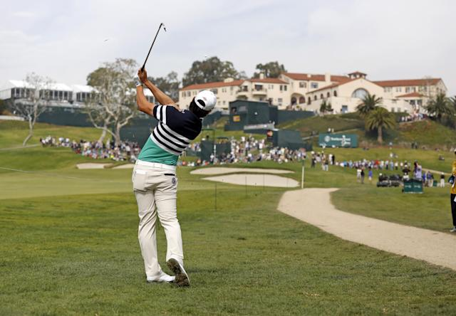 Sang-Moon Bae, of South Korea, makes his approach from the rough to the ninth green during the third round of the Northern Trust Open golf tournament at Riviera Country Club in the Pacific Palisades area of Los Angeles Saturday, Feb. 15, 2014. (AP Photo/Reed Saxon)