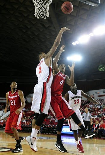 Georgia forward Marcus Thornton (2) blocks a shot by Youngstown State guard Shawn Amiker (4) during an NCAA college basketball game on Monday, Nov. 12, 2012, in Athens, Ga. (AP Photo/Athens Banner-Herald, Richard Hamm)
