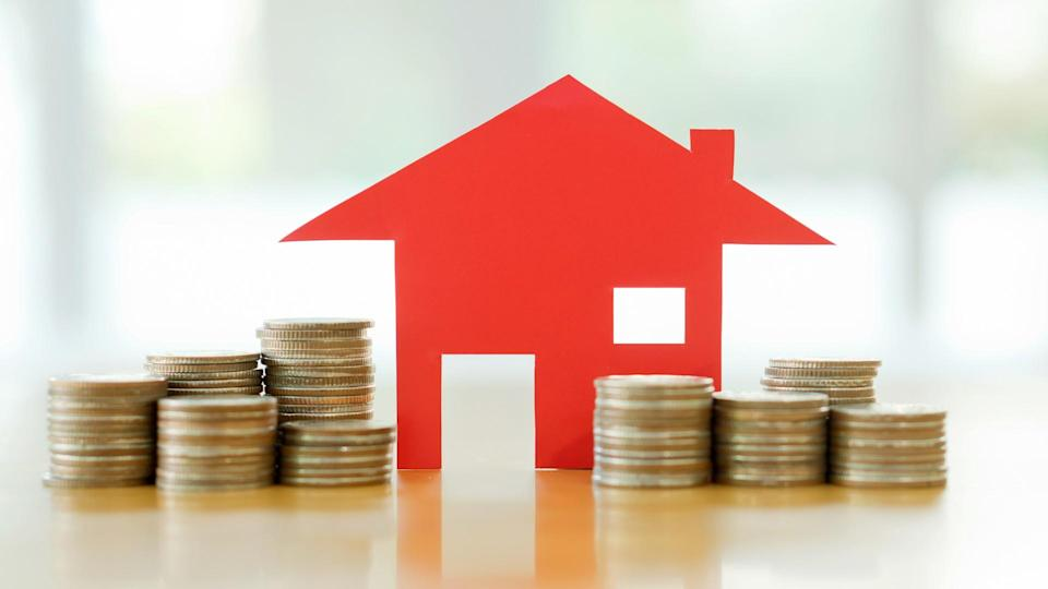 Mortgage concept by money house from the coins.