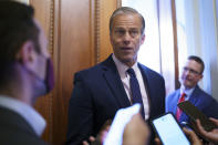 Senate Minority Whip John Thune, R-S.D., talks to reporters outside his office as the Senate works to advance the $1 trillion bipartisan infrastructure bill, at the Capitol in Washington, Monday, Aug. 2, 2021. The 2,700-page bill includes new expenditures on roads, bridges, water pipes broadband and other projects, plus cyber security. (AP Photo/J. Scott Applewhite)