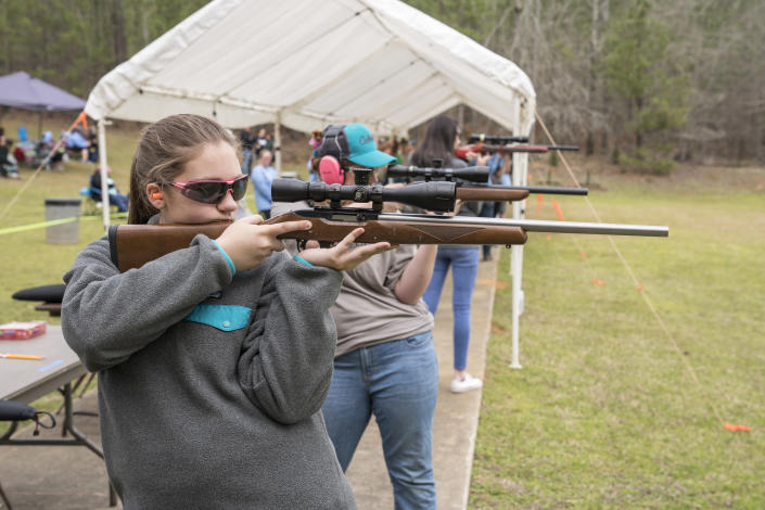 Participants lining up before the .22 Rimfire Silhouette Exhibition Match at the Rock Eagle 4-H Conference Center in Eatonton, Ga. (Photo: Ben Rollins for Yahoo News)