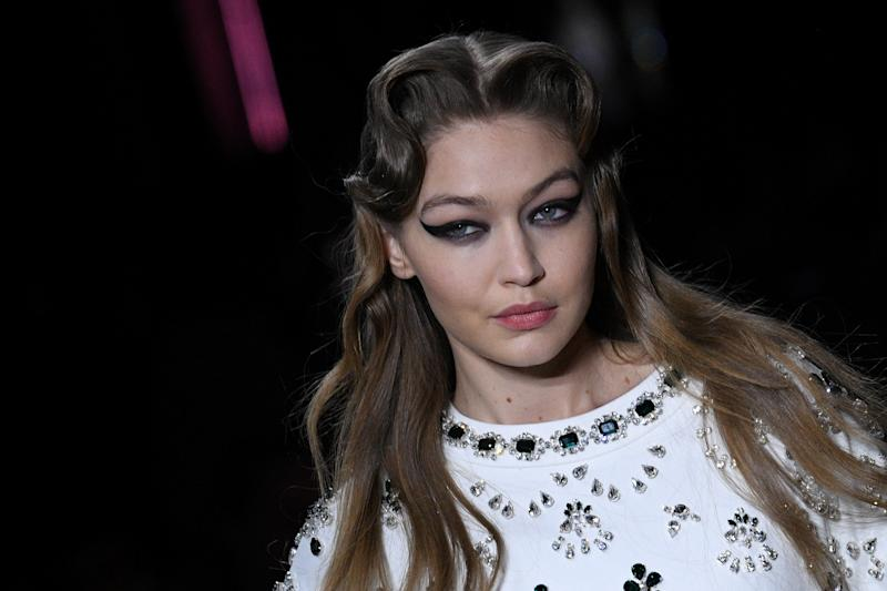 US model Gigi Hadid presents a creation for Miu Miu during the Women's Fall-Winter 2020-2021 Ready-to-Wear collection fashion show in Paris, on March 3, 2020. (Photo by Anne-Christine POUJOULAT / AFP) (Photo by ANNE-CHRISTINE POUJOULAT/AFP via Getty Images)