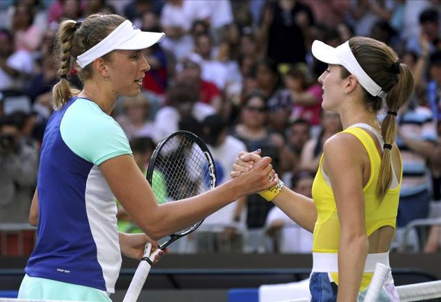 Belgium's Elise Mertens, left, is congratulated by CiCi Bellis of the U.S. after winning their third round singles match at the Australian Open tennis championship in Melbourne, Australia, Saturday, Jan. 25, 2020. (AP Photo/Lee Jin-man)
