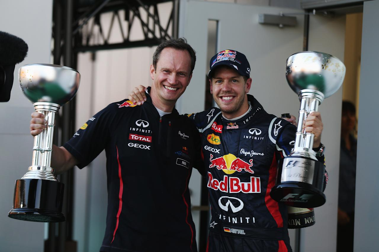 SUZUKA, JAPAN - OCTOBER 07:  Sebastian Vettel of Germany and Red Bull Racing celebrates on the podium with Red Bull Racing Head of Car Engineering Paul Monaghan after winning the Japanese Formula One Grand Prix at the Suzuka Circuit on October 7, 2012 in Suzuka, Japan.  (Photo by Mark Thompson/Getty Images)