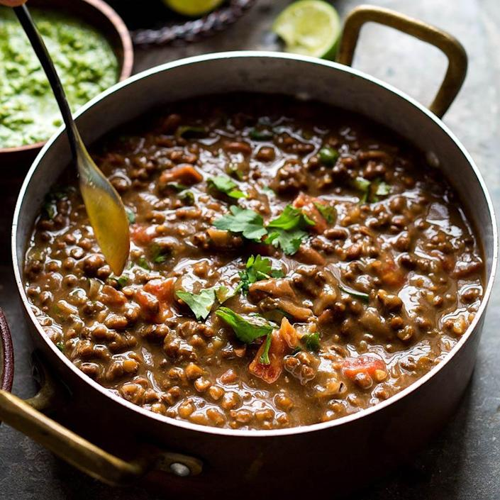 <p>Using a slow cooker for this dal curry recipe is brilliant--the lentils cook until they're perfectly tender. For the creamiest results, use whole urad dal (versus split), which you can get online or at Indian markets. This particular bean breaks down beautifully, giving the dish its rich, creamy texture. For a stovetop variation, see below. Serve it over rice with Indian-style green chutney and a side of plain yogurt.</p>