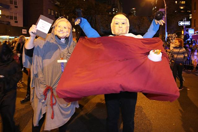 <p>People dressed as Hillary Clinton and Donald Trump march in the 44th annual Village Halloween Parade in New York City on Oct. 31, 2017. (Photo: Gordon Donovan/Yahoo News) </p>