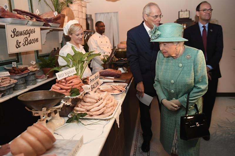 Queen Elizabeth II inside a pop-up replica of an early Sainsbury's shop in Covent Garden, London, in honor of the store's 150th anniversary, May 2019.