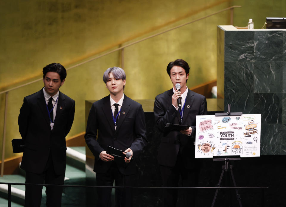 ADDS IDS - Members of of South Korean K-pop band BTS, from left, V, Suga and Jin appear at the United Nations meeting on Sustainable Development Goals during the 76th session of the U.N. General Assembly, at U.N. headquarters on Monday, Sept. 20, 2021. (John Angelillo/Pool Photo via AP)