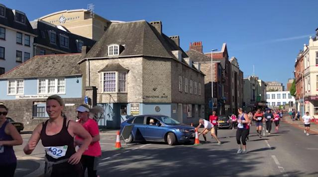 A woman in the U. K. decided to drive her car into the path of runners during the Plymouth Half Marathon over the weekend because she was angry about the road closures caused by the race.