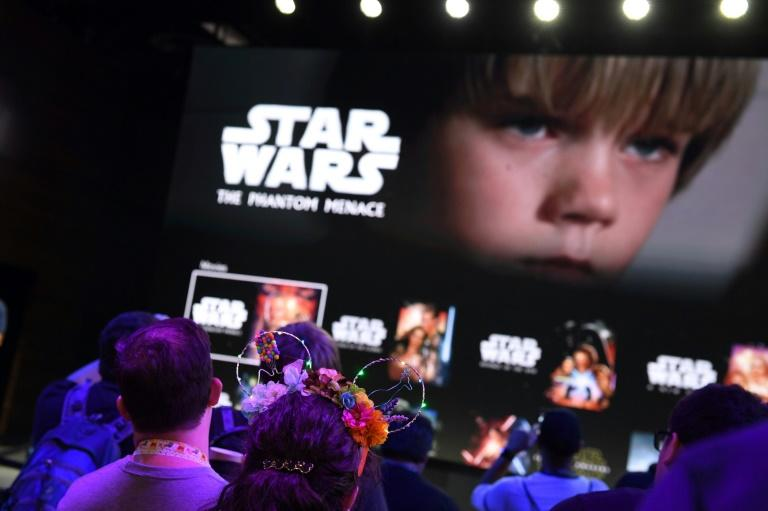 Attendees get a preview of the Disney+ streaming service interface at the D23 Expo