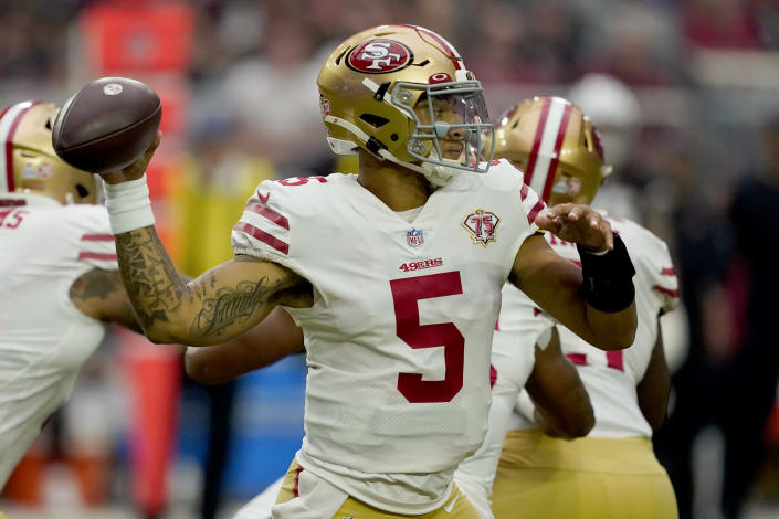 San Francisco 49ers quarterback Trey Lance (5) throws against the Arizona Cardinals during the first half of an NFL football game, Sunday, Oct. 10, 2021, in Glendale, Ariz. (AP Photo/Darryl Webb)