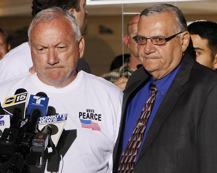 FILE -- In this Nov. 8, 2011, file photo, Arizona State Sen. Russell Pearce, R-Mesa, left, joins Maricopa County Sheriff Joe Arpiao during a press conference in Mesa, Ariz. Pearce, the sponsor of Arizona's groundbreaking SB1070 immigration enforcement law, and a close ally of the sheriff, was pushed out of politics in a recent recall election, leaving Arpaio the last man standing of the three Phoenix politicians who made Arizona a leader in the crackdown against illegal immigration. (AP Photo/Matt York, File)