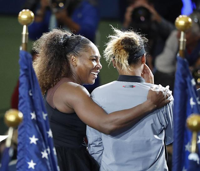 Serena Williams holds Naomi Osaka during the trophy presentation at the U.S Open.  (EFE)