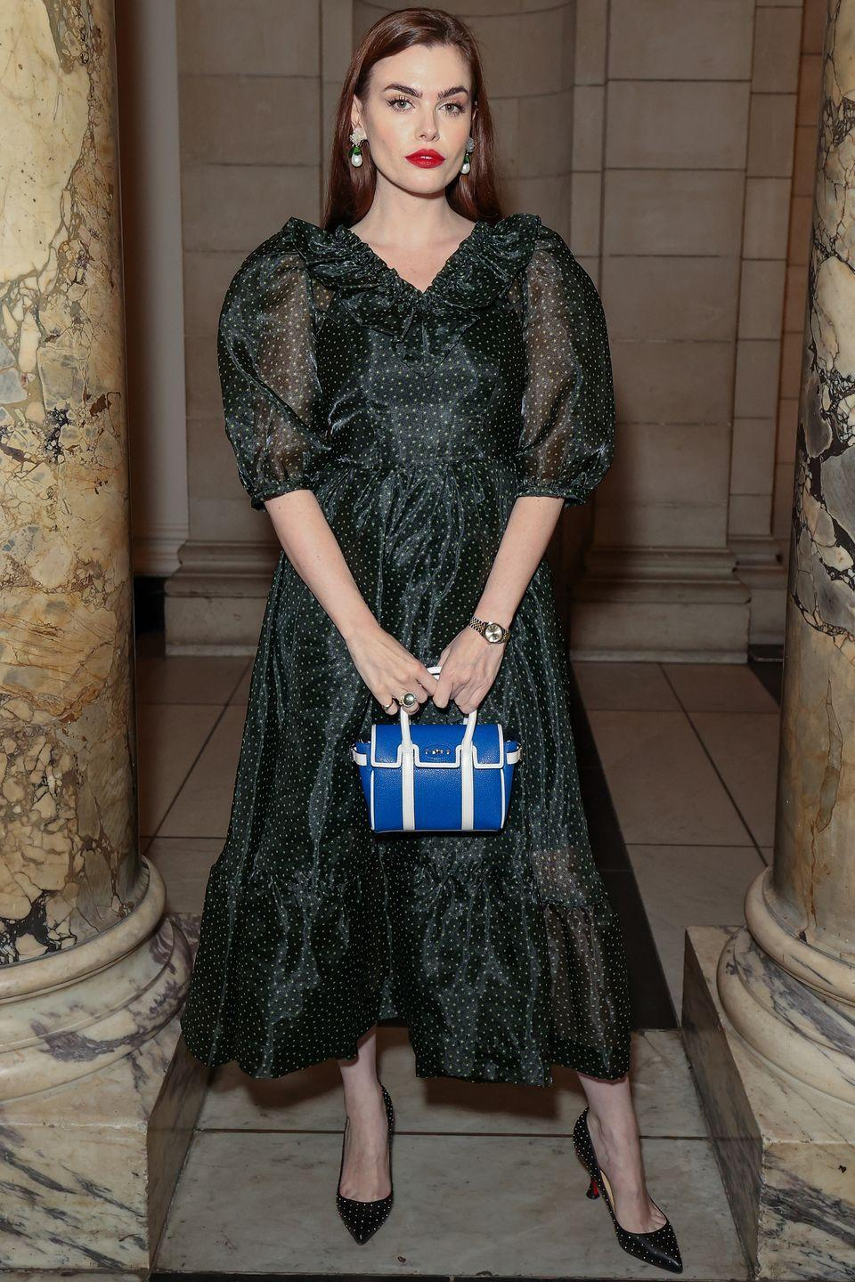 <p><strong>19 September</strong></p><p>Charli Howard opted for a sheer polka-dot dress for the show. </p>