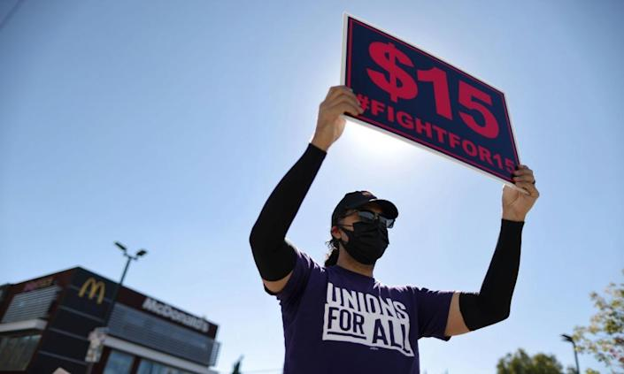Fast-food workers and supporters rally in Los Angeles on 18 February.
