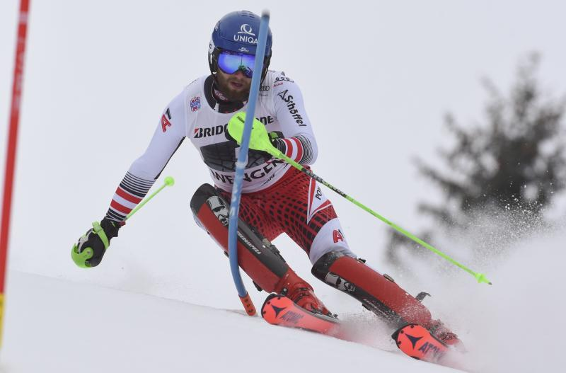 Austria's Marco Schwarz competes during an alpine ski, men's World Cup combined in Wengen, Switzerland, Friday, Jan. 18, 2019. (AP Photo/Marco Tacca)