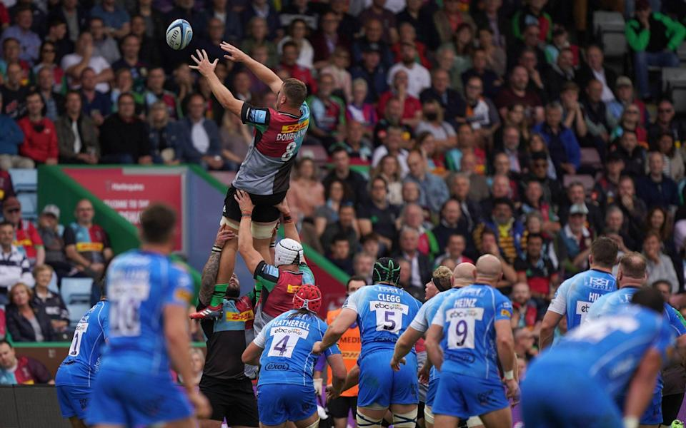 Alex Dombrandt catches a lineout during Quins' clash with Worcester - PA