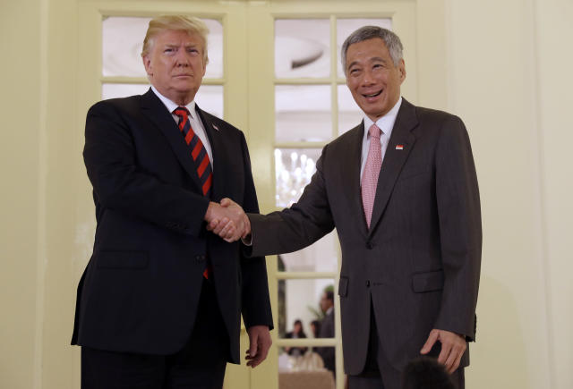 <p>President Donald Trump shakes hands as he meets with Singapore Prime Minister Lee Hsien Loong ahead of a summit with North Korean leader Kim Jong Un, June 11, 2018, in Singapore. (Photo: Evan Vucci/AP) </p>