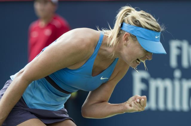 Maria Sharapova of Russia celebrates a point over Garbine Muguruza of Spain during second round of play at the Rogers Cup tennis tournament Wednesday Aug. 6, 2014 in Montreal. (AP Photo/The Canadian Press, Paul Chiasson)