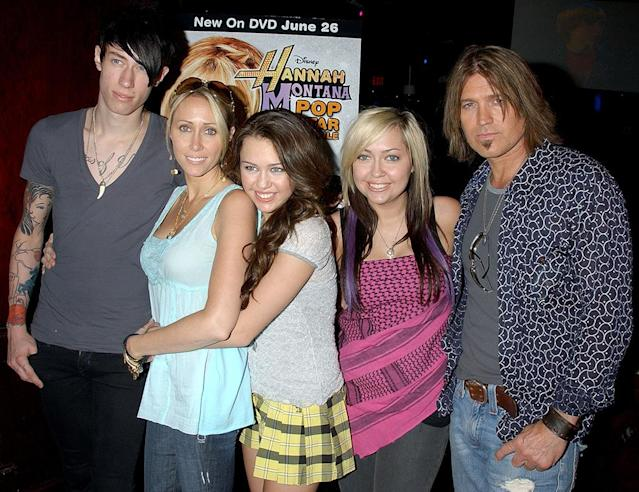 <p>There's Trace! Miley's rocker bro joined the fam way back in 2007 for Miley's free concert celebrating the DVD release of <em>Hannah Montana: Pop Star Profile</em>. He's rarely been snapped with them since. (Photo: Gregg DeGuire/WireImage) </p>