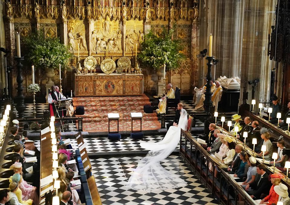 Prince Harry and Meghan Markle listen to an address by the Most Rev Bishop Michael Curry, primate of the Episcopal Church, in St George's Chapel at Windsor Castle during their wedding service.