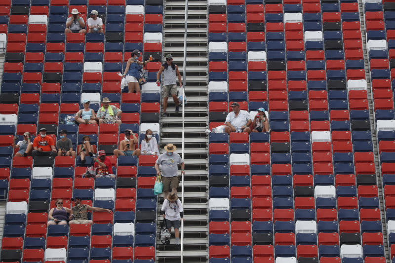Fans dot the stands prior to a NASCAR Cup Series auto race at Talladega Superspeedway in Talladega Ala., Sunday, June 21, 2020. (AP Photo/John Bazemore)