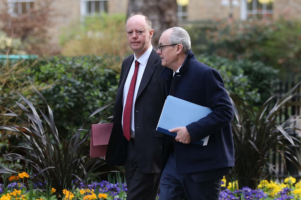 Chief medical adviser to the UK government Chris Whitty (left) and the chief scientific adviser to the UK government Patrick Vallance (right) arrive in Downing Street on March 3, 2020. (Photo: ISABEL INFANTES via Getty Images)