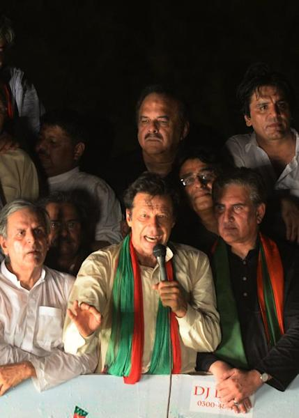 Pakistan cricketer-turned-politician Imran Khan addresses supporters in Lahore on August 14, 2014 as he heads a protest march from Lahore to Islamabad against the government