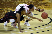 Stanford guard Kiana Williams (23) and Oregon guard Te-Hina Paopao (12) battle for the ball during the third quarter of an NCAA college basketball game Monday, Feb. 15, 2021, in Eugene, Ore. (AP Photo/Andy Nelson)