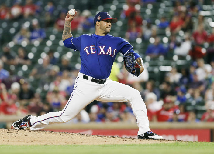 FILE - In this March 26, 2018, file photo, Texas Rangers relief pitcher Matt Bush throws in the sixth inning during a spring training baseball game against the Cincinnati Reds in Arlington, Texas. This comeback is much different for Bush, who has not pitched for the Rangers since 2018 because of two elbow operations. The reliever's other comeback was part of a darker period that involved alcohol and a DUI accident that sent him to prison for nearly four years. (AP Photo/Brandon Wade, File)