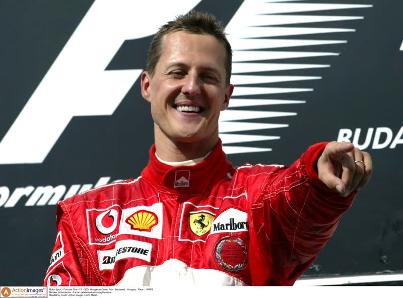 FILE PHOTO: Michael Schumacher - Ferrari celebrates winnning the race