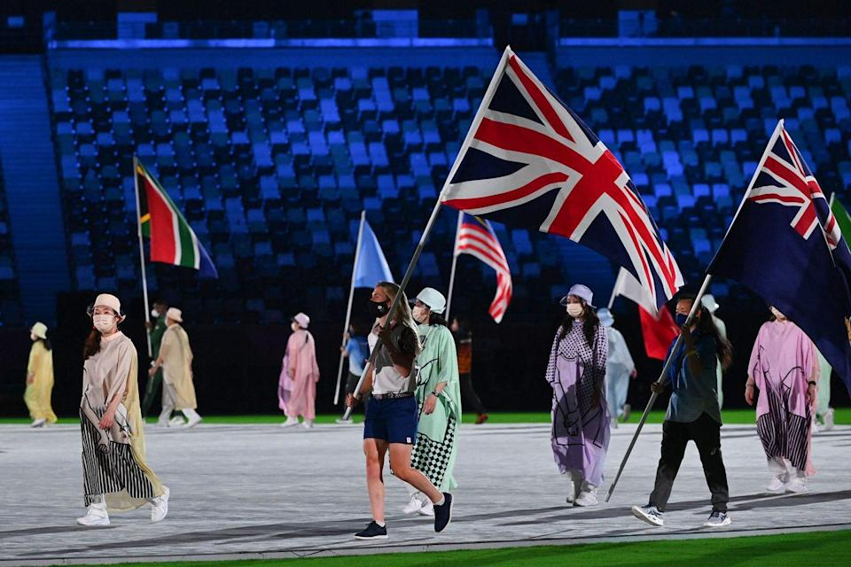 """<p>Olympic cyclist Laura Kenny was the official flagbearer for Great Britain at the closing ceremony. Ahead of the event, she said it was """"an absolute honour to be selected as the Team GB flagbearer for the Tokyo 2020 Closing Ceremony, and it rounds off my Games experience"""". In total, Team GB finished with 65 medals - 22 of which were gold - making them fourth in the overall medal table.</p>"""