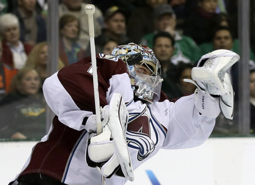 Colorado Avalanche goalie Semyon Varlamov (1), of Russia, stops a shot from the Dallas Stars in the first period of an NHL hockey game, Monday, Jan. 27, 2014, in Dallas. (AP Photo/Tony Gutierrez)